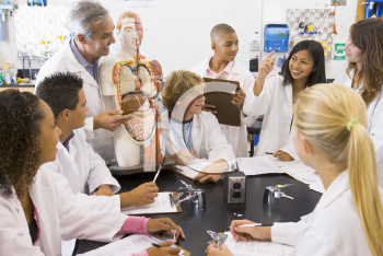Royalty Free Photo of a Teacher and Students in a Biology Class