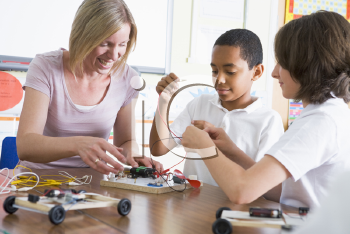 Royalty Free Photo of Students and a Teacher Making Electronic Cars