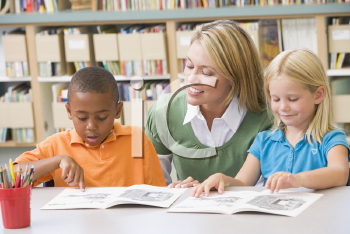 Royalty Free Photo of Students Reading With a Teacher