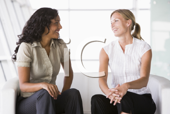 Royalty Free Clipart Image of Two Businesswomen