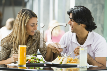 Royalty Free Photo of a Couple Eating at a Restaurant