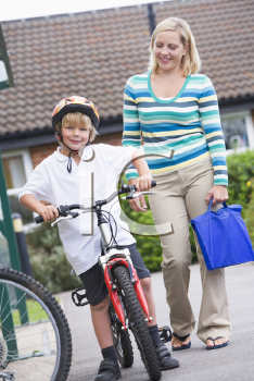 Royalty Free Photo of a Boy and His Mother Outside School