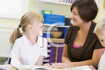 Royalty Free Photo of a Teacher and Student Reading