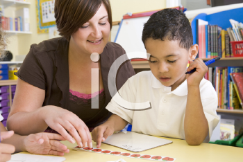 Royalty Free Photo of a Teacher and Boy Counting