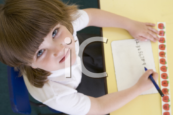 Royalty Free Photo of a Student Writing Numbers