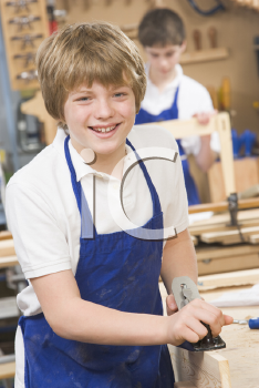 Royalty Free Photo of a Student Woodworking
