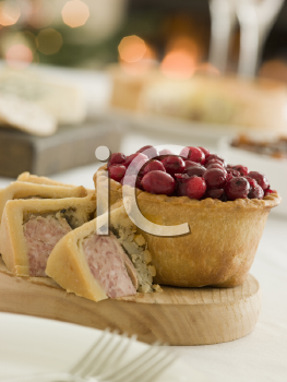 Royalty Free Photo of a Pork Turkey and Stuffing Pie Cranberry and Game Pie