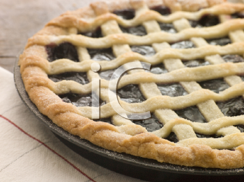 Royalty Free Photo of a Hot Cherry Lattice Pie