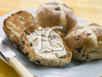 Royalty Free Photo of a Plate of Toasted Hot Cross Buns With Butter