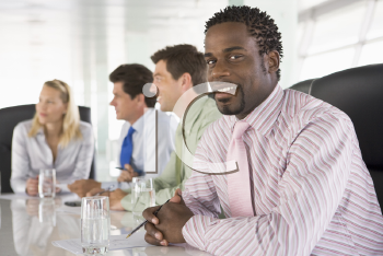 Royalty Free Photo of Four People in a Boardroom