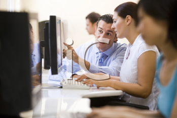 Royalty Free Photo of People in a Computer Class