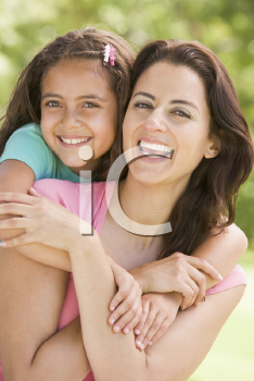 Royalty Free Photo of a Mother and Daughter Hugging Outside