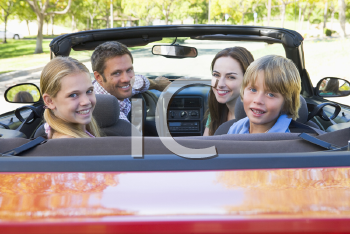 Royalty Free Photo of a Family in a Convertible