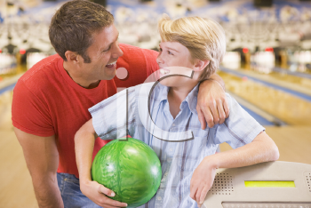 Royalty Free Photo of a Man and Boy at the Bowling Alley