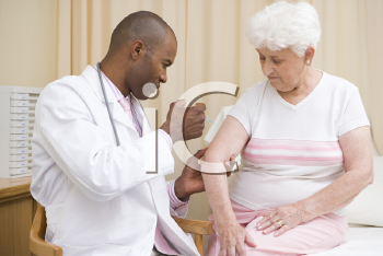 Royalty Free Photo of a Doctor Giving a Woman a Needle