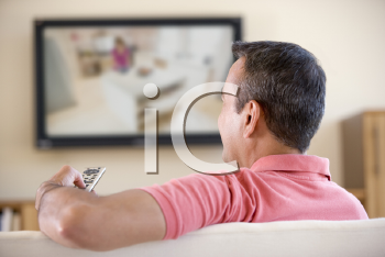 Royalty Free Photo of a Man Watching Television