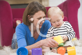 Royalty Free Photo of a Mother Playing With Her Baby
