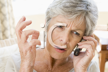 Royalty Free Photo of a Frowning Woman Talking on the Phone