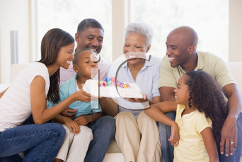 Royalty Free Photo of a Family With Birthday Cake