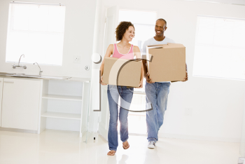 Royalty Free Photo of a Couple Moving In