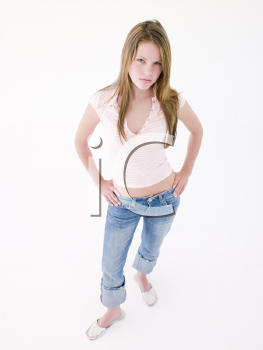 Teenage girl with hands on hips frowning