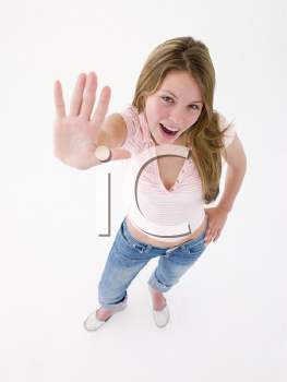 Teenage girl with hand up smiling