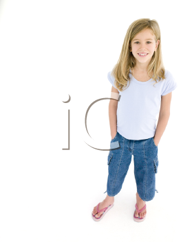 Young girl with hands in pockets smiling