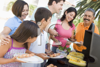 Royalty Free Photo of a Family Enjoying a Barbecue
