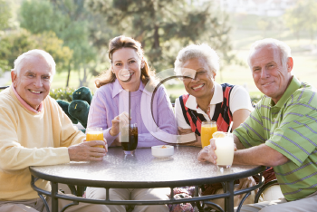 Royalty Free Photo of Friends Enjoying a Beverage at a Golf Course