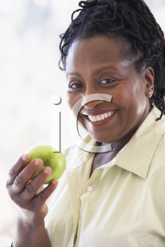 Royalty Free Photo of a Woman With an Apple
