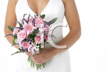Royalty Free Photo of a Bride Holding Her Flowers