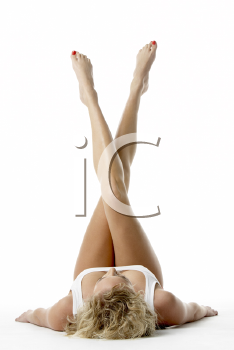 Royalty Free Photo of a Young Woman With Her Legs in the Air