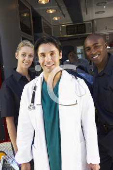 Royalty Free Photo of Paramedics and a Doctor in Front of an Amublance
