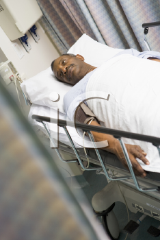 Royalty Free Photo of a Patient in a Hospital Bed