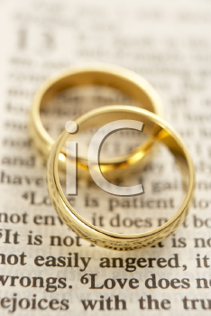Royalty Free Photo of Two Wedding Rings on the Page of a Bible