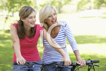 Royalty Free Photo of a Mother and Daughter on Bikes