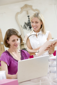 Royalty Free Photo of Two Women Looking at a Laptop