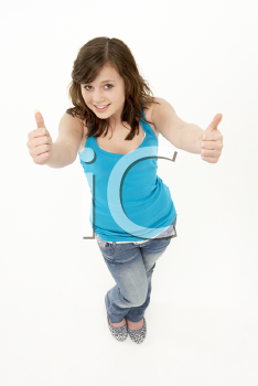Royalty Free Photo of a Girl Giving Thumbs Up