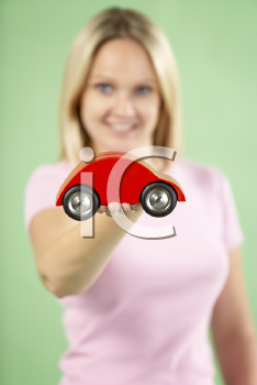 Royalty Free Photo of a Woman With a Toy Car
