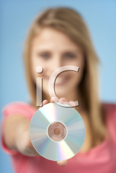 Royalty Free Photo of a Teenage Girl With a DVD