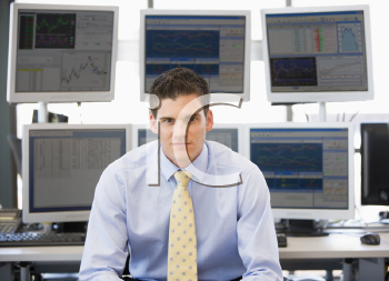 Royalty Free Photo of a Stock Trader in Front of Monitors