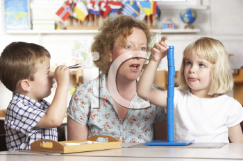 Royalty Free Photo of a Teacher at Playschool