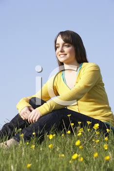 Royalty Free Photo of a Young Girl in a Field of Buttercups