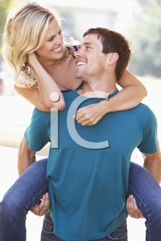 Royalty Free Photo of a Couple Having Fun Outdoors