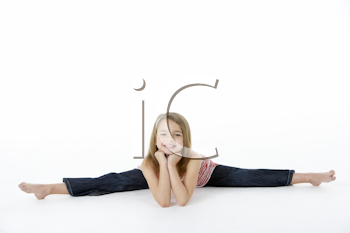 Young Girl In Gymnastic Pose Doing Splits