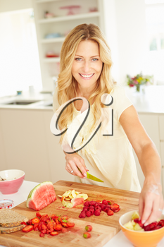 Woman Preparing Healthy Breakfast In Kitchen