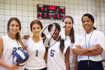 Members Of Female High School Volleyball Team With Coach