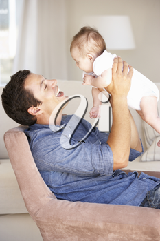 Young Father On Sofa At Home