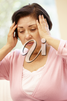 Senior Hispanic woman with headache