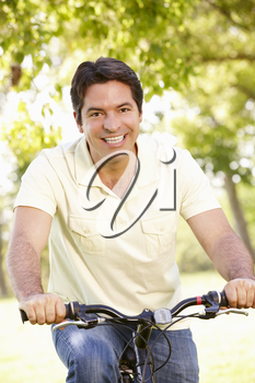 Young Hispanic Man Cycling In Park